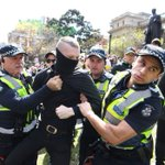 Rival groups face off in Melbourne as police test new anti-mask laws