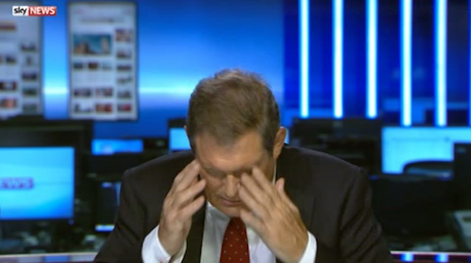 Bizarre moment Sky News reporter puts his head in his hands and STOPS talking after blunder during live report
