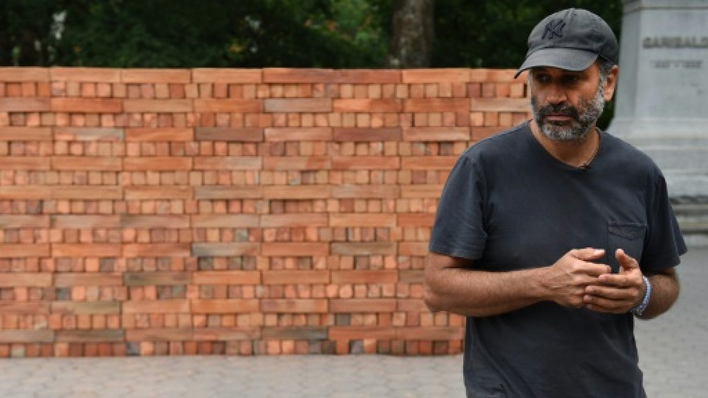 Mexican artist builds wall to tear down in New York