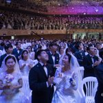 Thousands marry in Unification Church wedding