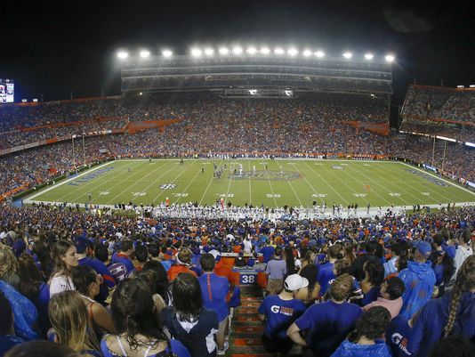Canceling football games due to Hurricane Irma brings financial complications for schools.