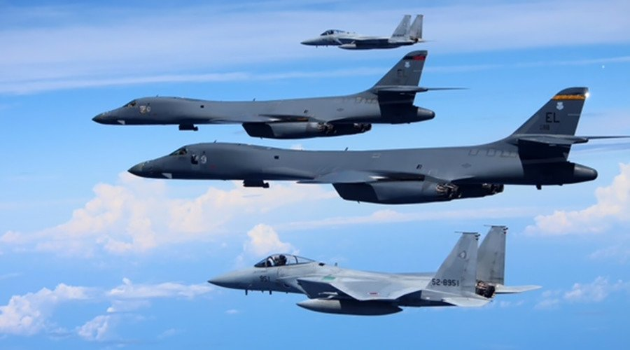 Japanese jet fighters & US bombers conduct war games over East China Sea