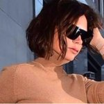 Victoria Beckham goes braless to her New York Fashion Week Show as husband David and son Brooklyn sit front row