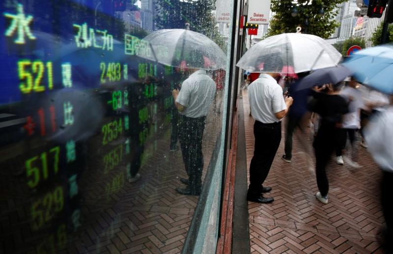 Asia shares join global rally, hit 10-year high on Irma, North Korea relief