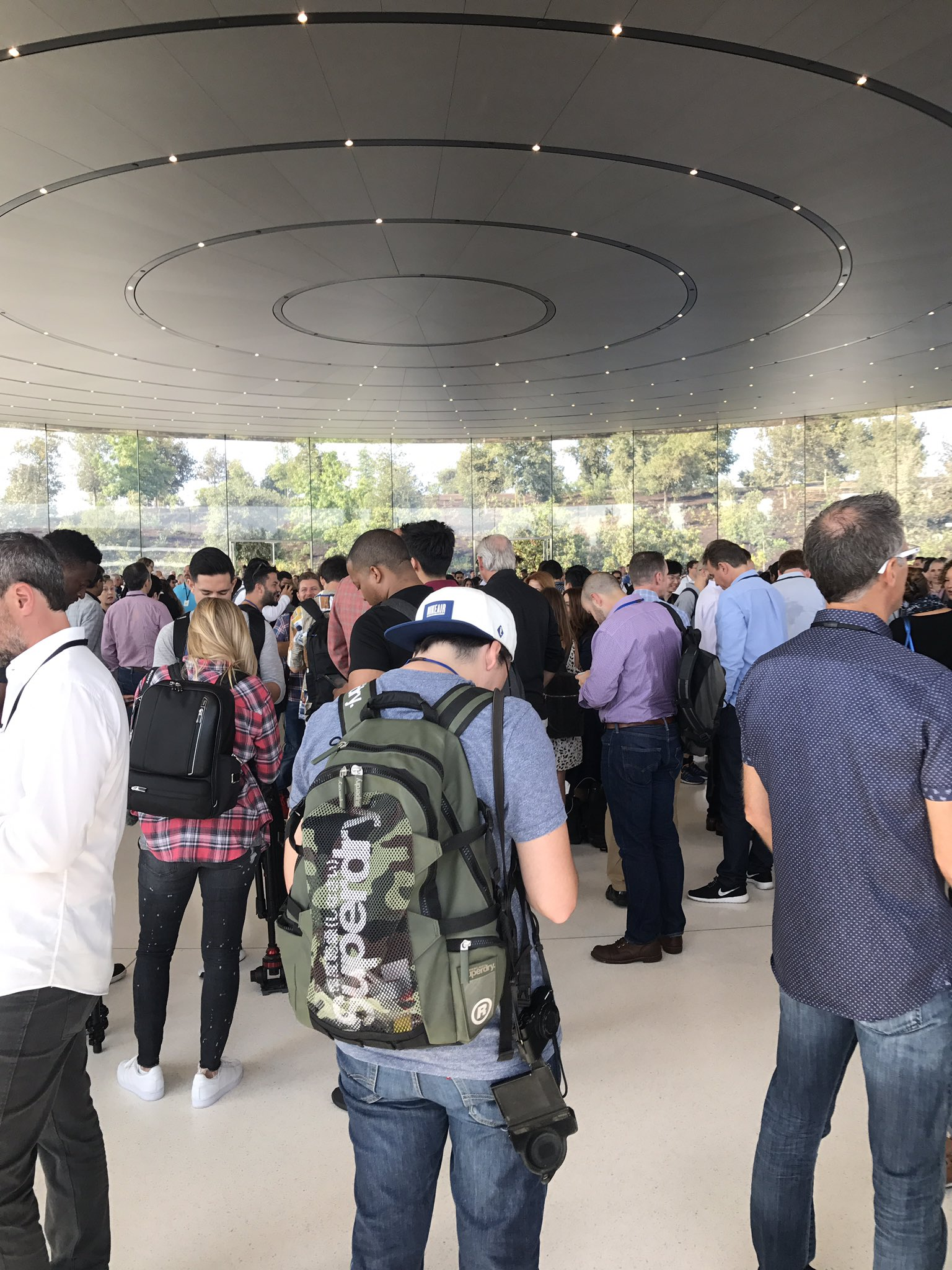 Entrance to steve jobs theater. We're walking down into this hole. https://t.co/551SLHI5Il