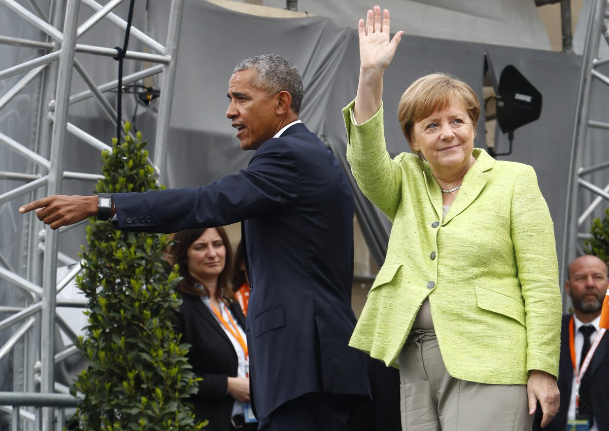 Barack Obama is campaigning for Germany's Angela Merkel—well, his face is anyway