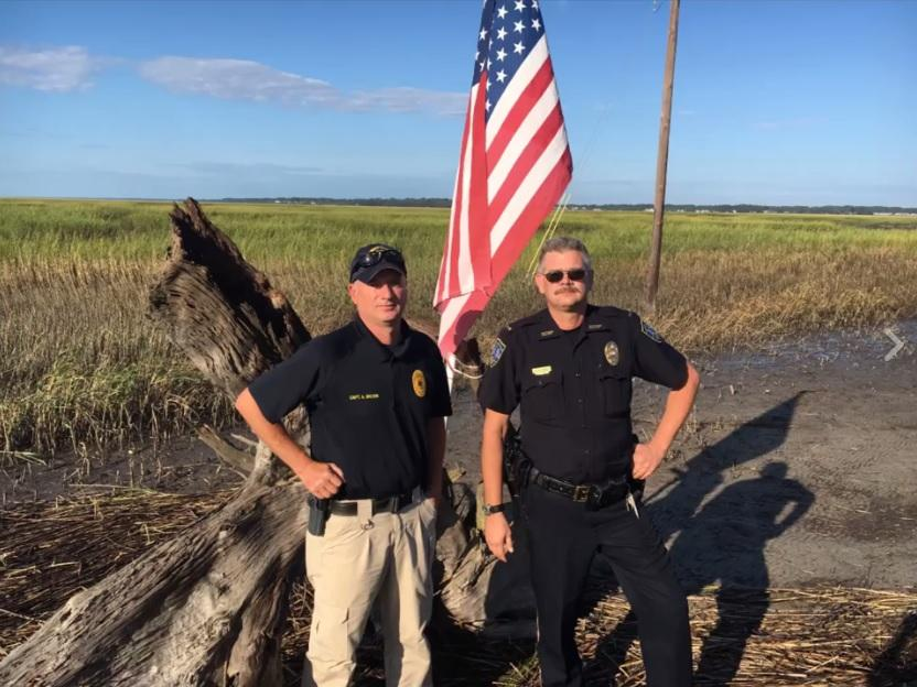 Georgia officers step in to save American flag knocked down by Hurricane Irma