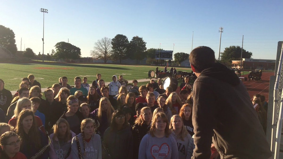 Dan Mangold, director of bands at MOC-FV, addresses his marching band