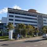 Workers start to pull unsafe cladding down from Brisbane hospital