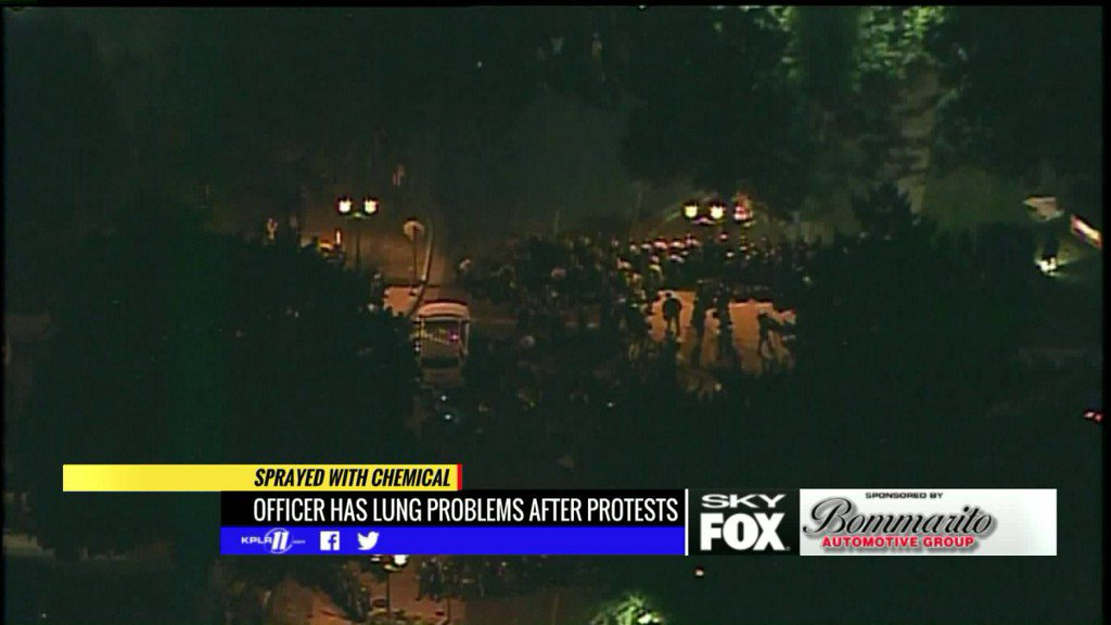 Police say officer has health complications after protester's chemical spray