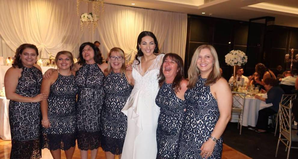 Six women attend Sydney wedding wearing identical dress