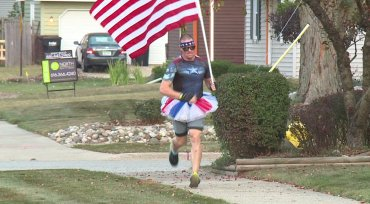 Why a Michigan man carries an American flag and wears a tutu on his morningrun