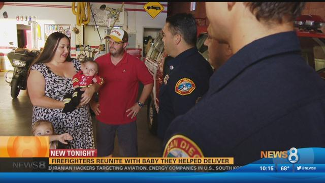 Firefighters reunite with baby they helped deliver