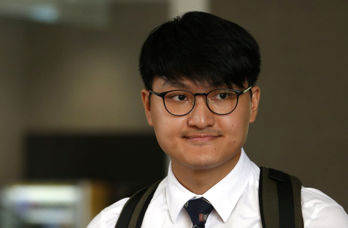 Former Hong Kong student leader escapes jail sentence for campus protest