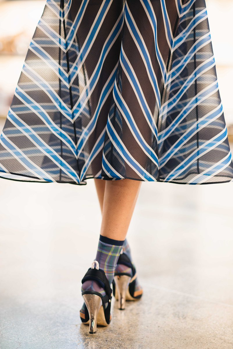 Skirts hug the waist-high while tops drape off-the-shoulder. #FendiSS18 https://t.co/YQH0cmSQpG