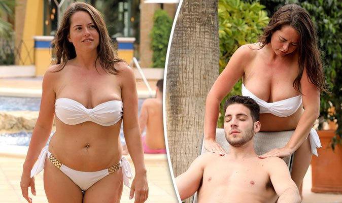 Karen Danczuk Spills Out Of Busty Bikini As She Gives Toyboy A Saucy Massage In Spain