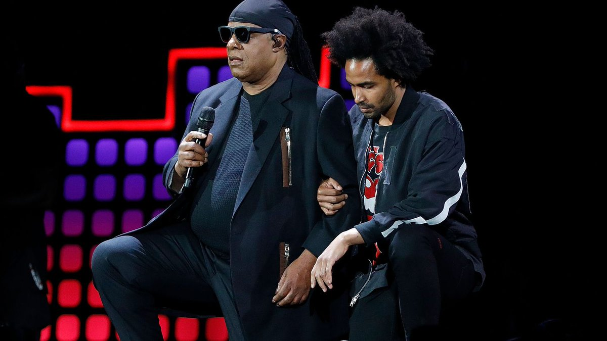 Stevie Wonder Kneels 'For America' At Global Citizen Festival