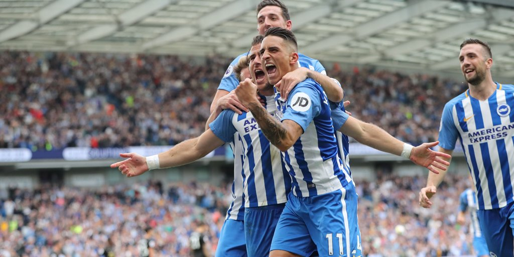 Tomer Hemed celebrates with his Albion teammates after breaking the de...
