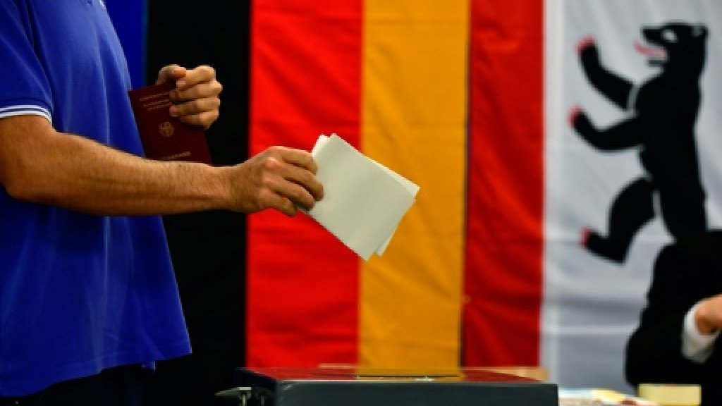 In Germany, voters torn between stability and change