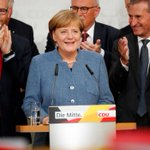 German election: Angela Merkel hangs on to power but forced to form coalition after losing support to far-right
