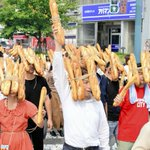 With baguettes strapped to faces, 'Bread Man' parade celebrates contemporary art