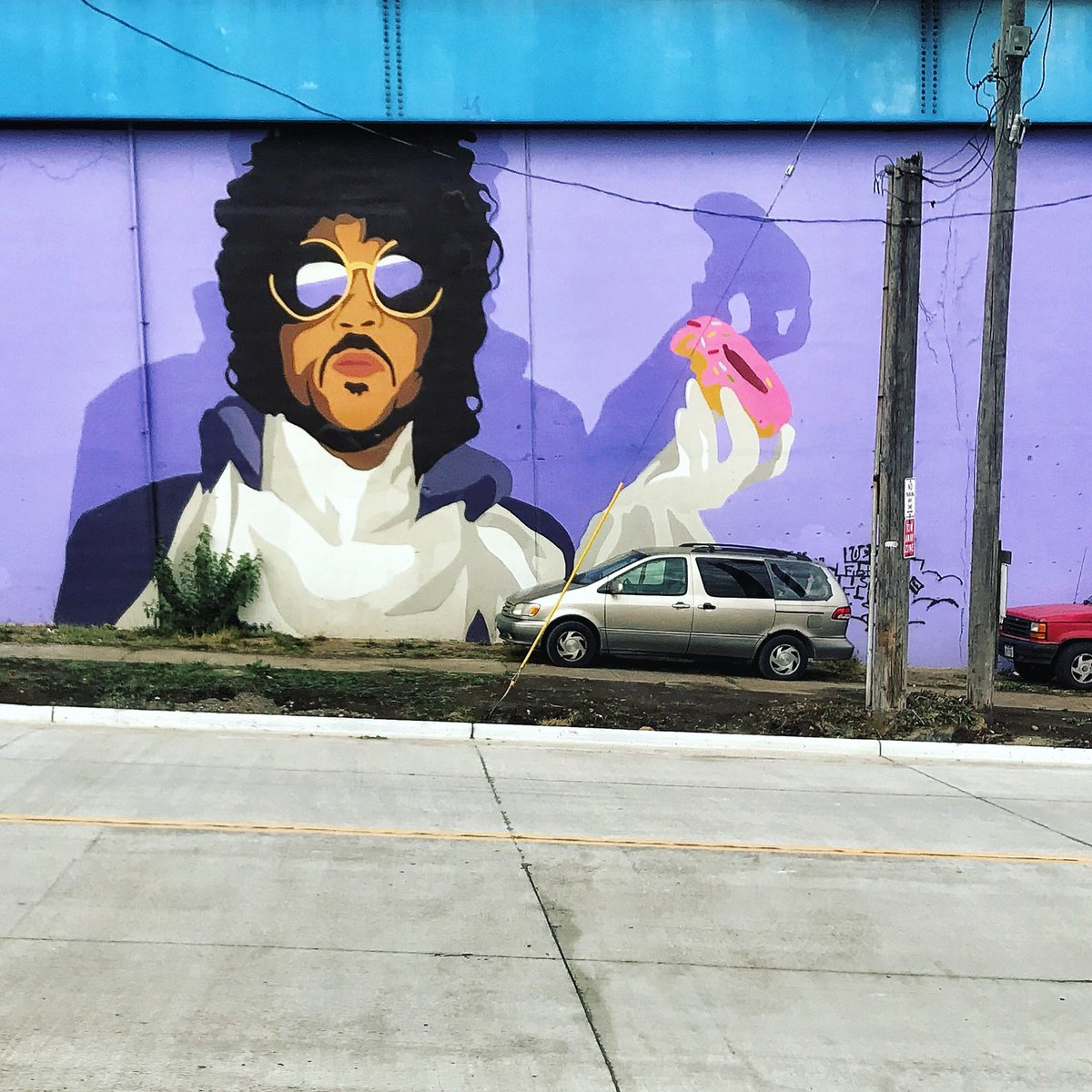 RT @JoshMBernstein: In other news, did you know that Cleveland has a mural of Prince eating a donut? https://t.co/8n752TxOoi