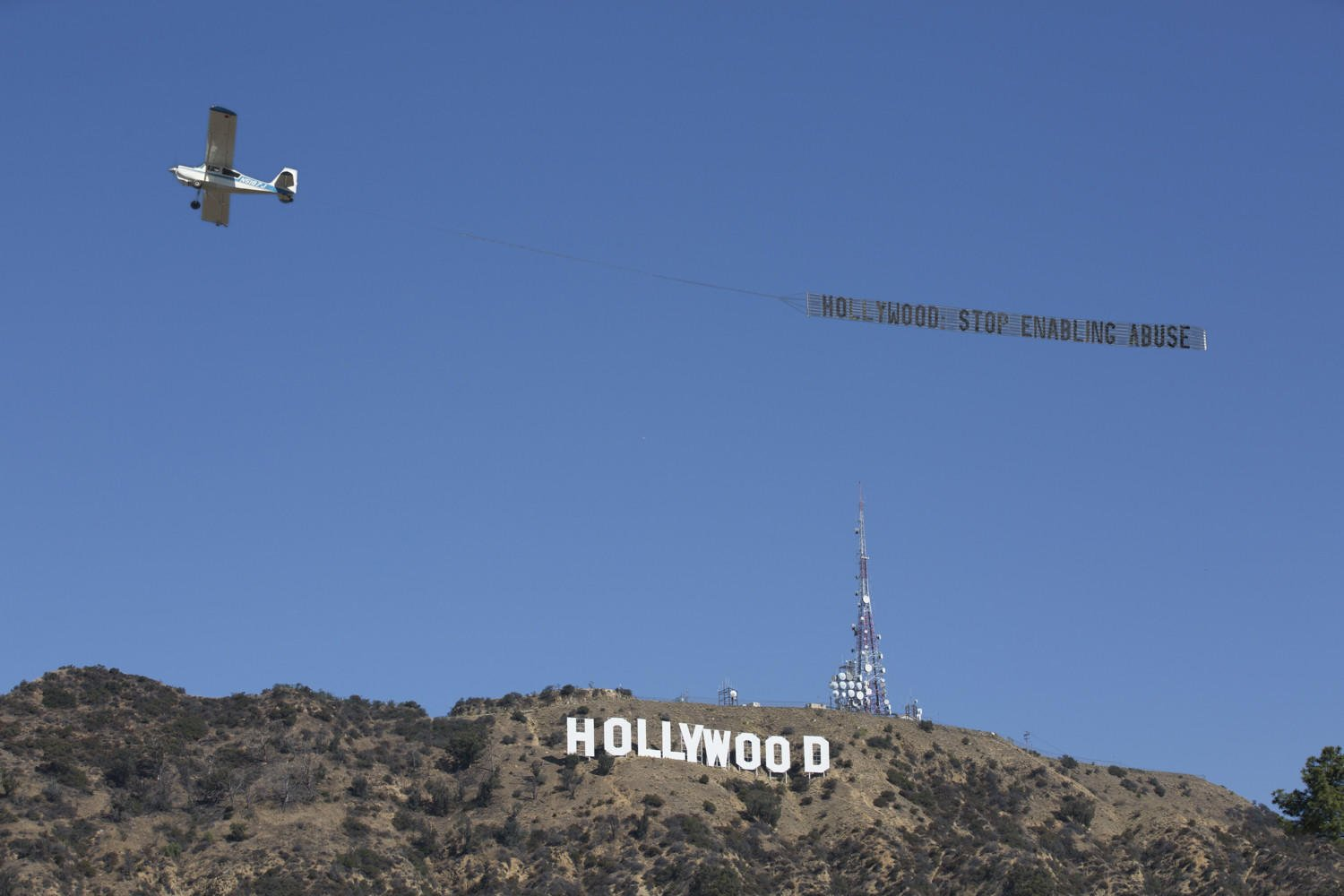 A banner seen over Los Angeles demands Hollywood to 'stop enabling abuse' https://t.co/UmSC1sg0Np https://t.co/Pz5YvoUrqX