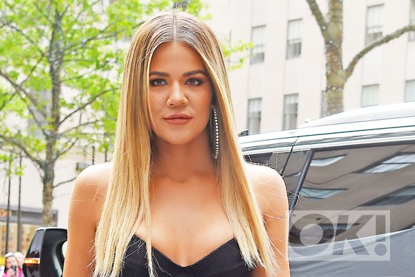 Khloe Kardashian cradles her stomach as she steps out amid 'pregnancy' rumours