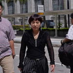 Mother of ex-national table tennis player Li Hu on trial for offering a bribe