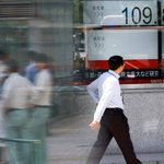 Japanese shares scale two year peak on auto rally; dollar slips