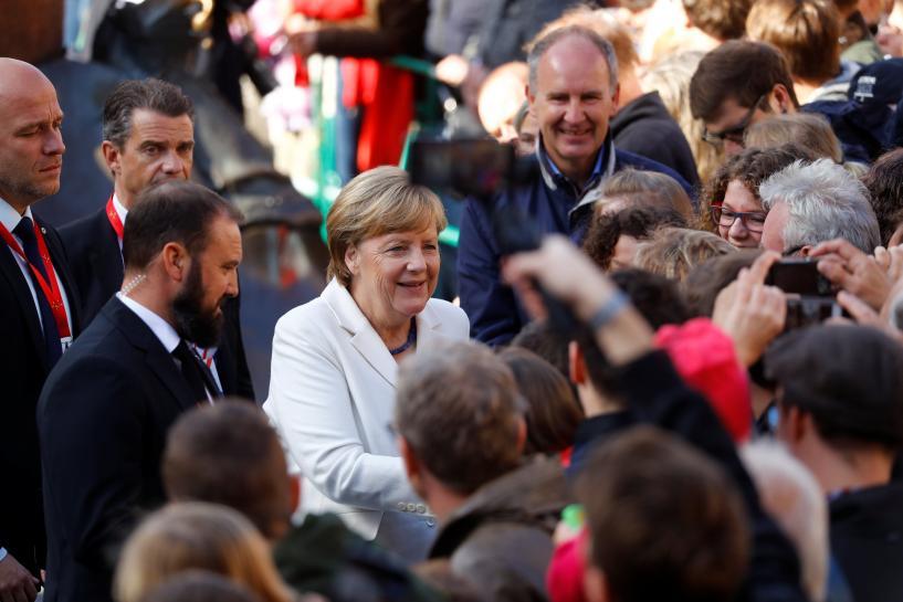 First German immigration law on agenda as Merkel seeks coalition