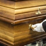 Dead man buried with money to 'bribe' God