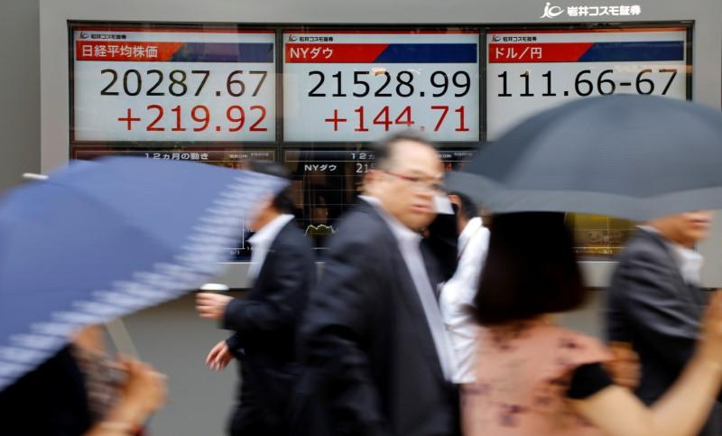 Asia shares firm to near ten-year high ahead of U.S. data, China Congress