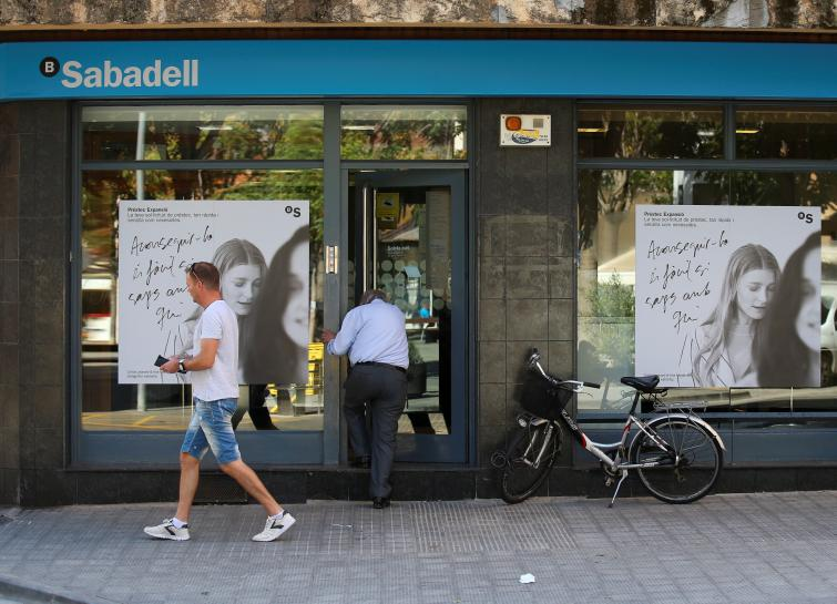 Two Spanish banks study moving HQ from Catalonia as business alarm deepens