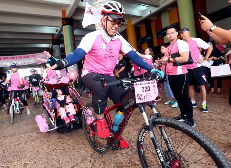 700 cyclists pedal across city in support of breast cancer awareness