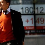 Asia shares inch ahead, Turkish lira takes a dive