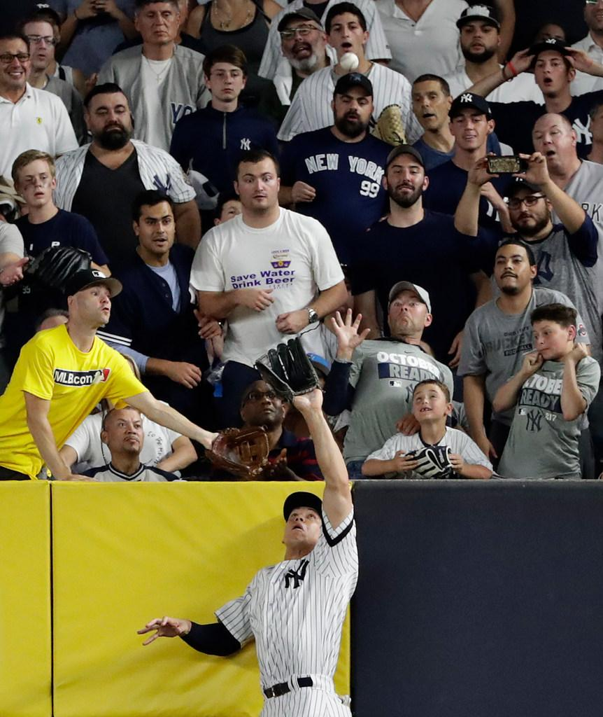 All rise for Aaron Judge's first career home run robbery. [Credit: Frank Franklin II/AP Photo] https://t.co/zrdfTxk3wR