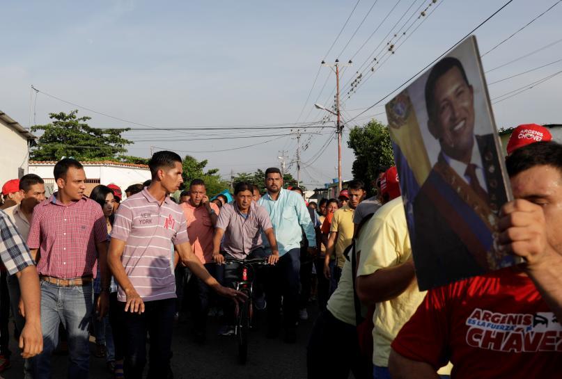 After bloodshed, Venezuelan government and foes battle for votes