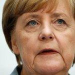 Merkel changes tune on German refugee cap