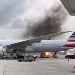 Fire breaks out near passenger jet at Hong Kong airport; one injured