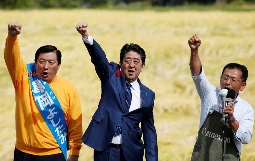 Japan's Abe takes aim at new parties in opening shots of election campaign