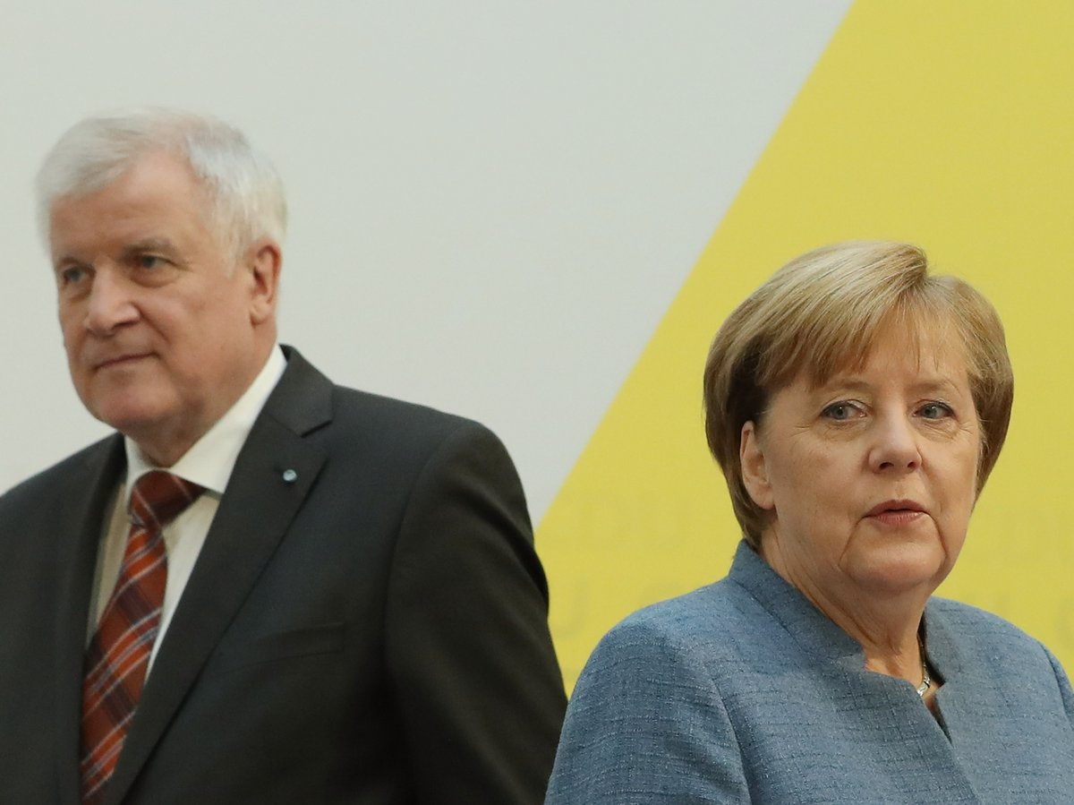 For the first time, Germany's Angela Merkel agrees to cap on asylum seekers