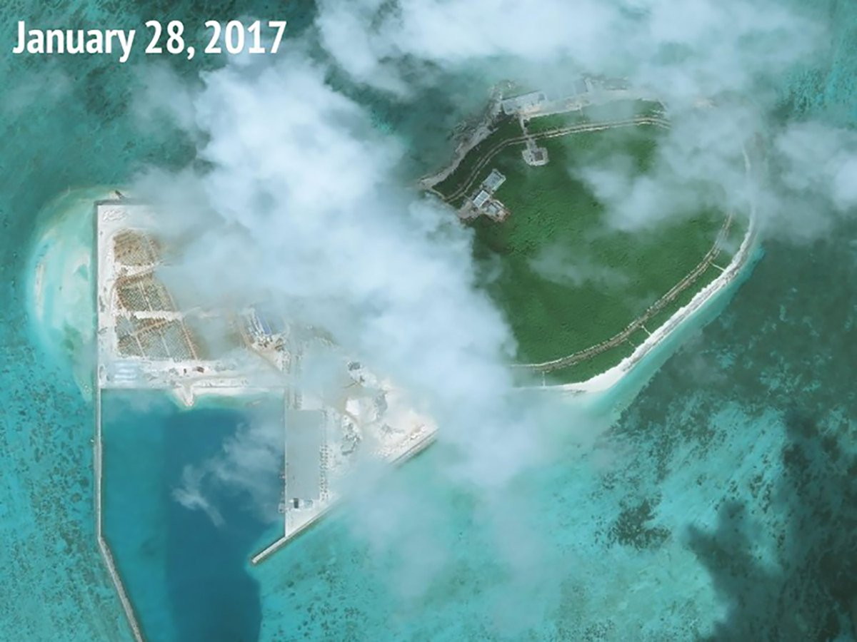 US warship sails near disputed islands in South China Sea, say US officials