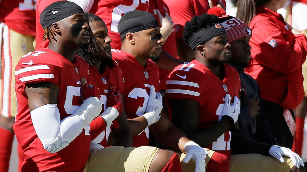 NFL row intensifies as players kneel and raise fists
