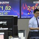Global stocks subdued as investors brace for earnings season