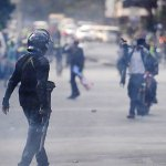 Kenya police use tear gas on opposition protests over vote