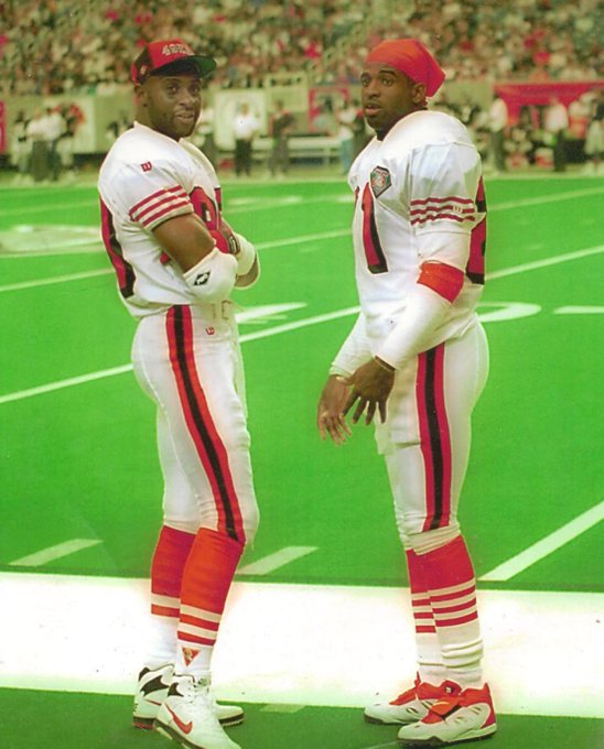 (1994) Legendary photo of Jerry Rice and Deion Sanders! Happy birthday to Jerry Rice!