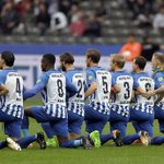 German soccer team takes a knee before Bundesliga game 'for a tolerant Berlin'