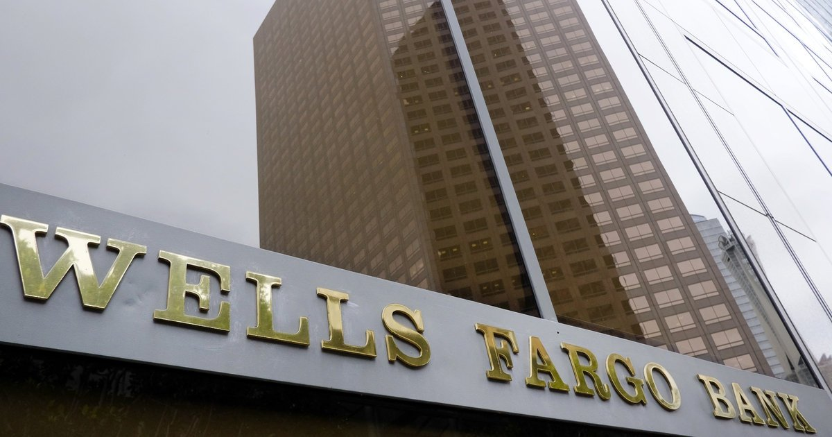 Wells Fargo's profits tumble as mega bank struggles to rebound from sales scandal