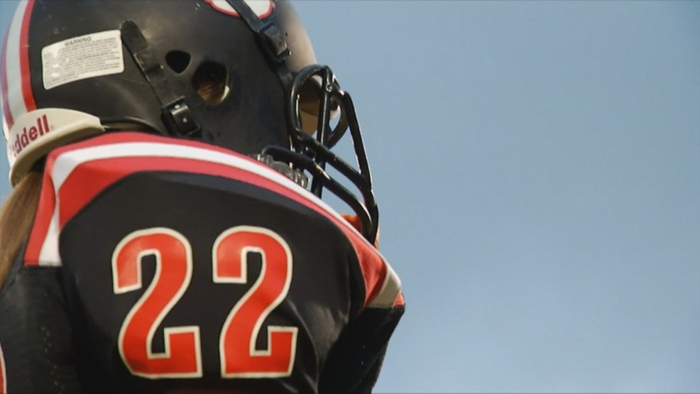 One of the toughest players on this high school football team is a girl